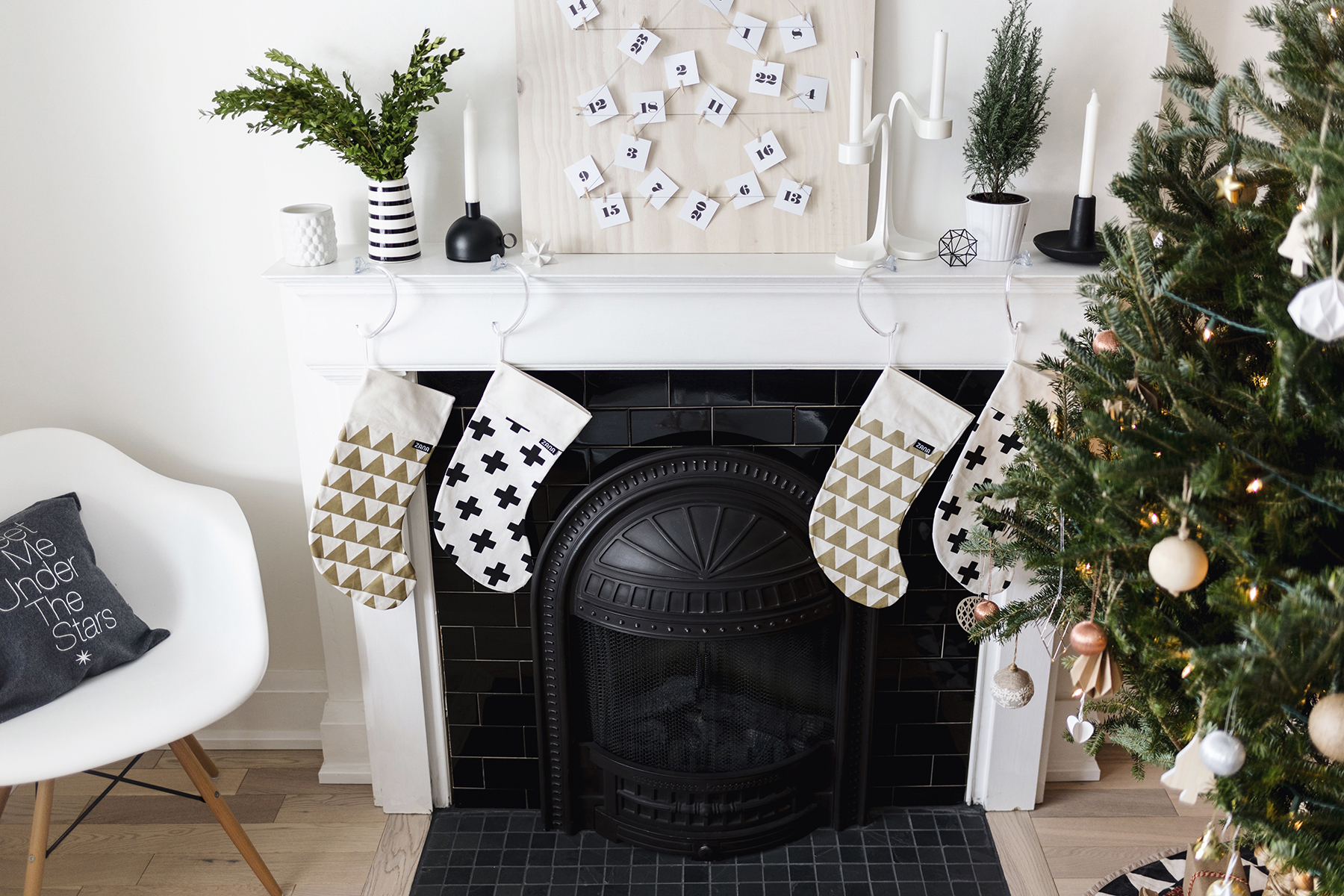 Scandinavian Christmas decor - fireplace mantle with modern stockings | Happy Grey Lucky