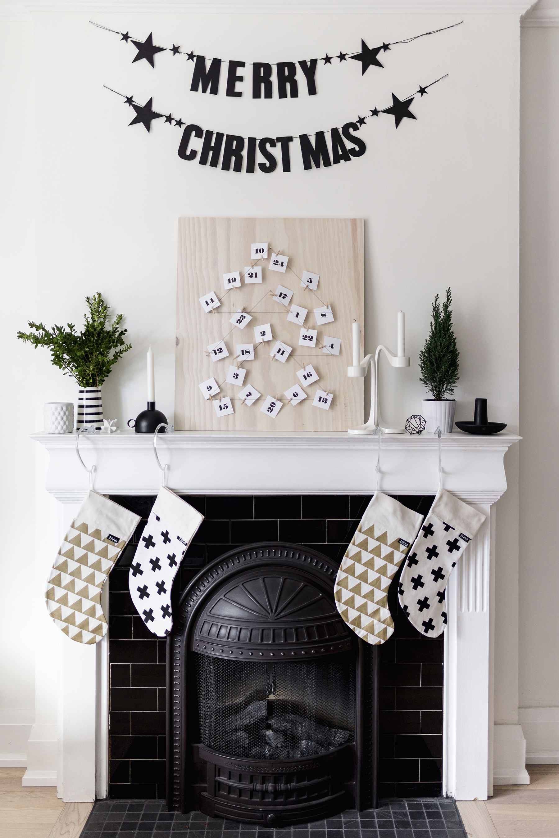 Scandinavian Christmas fireplace mantle - stockings, DIY advent calendar + Merry Christmas banner | Happy Grey Lucky