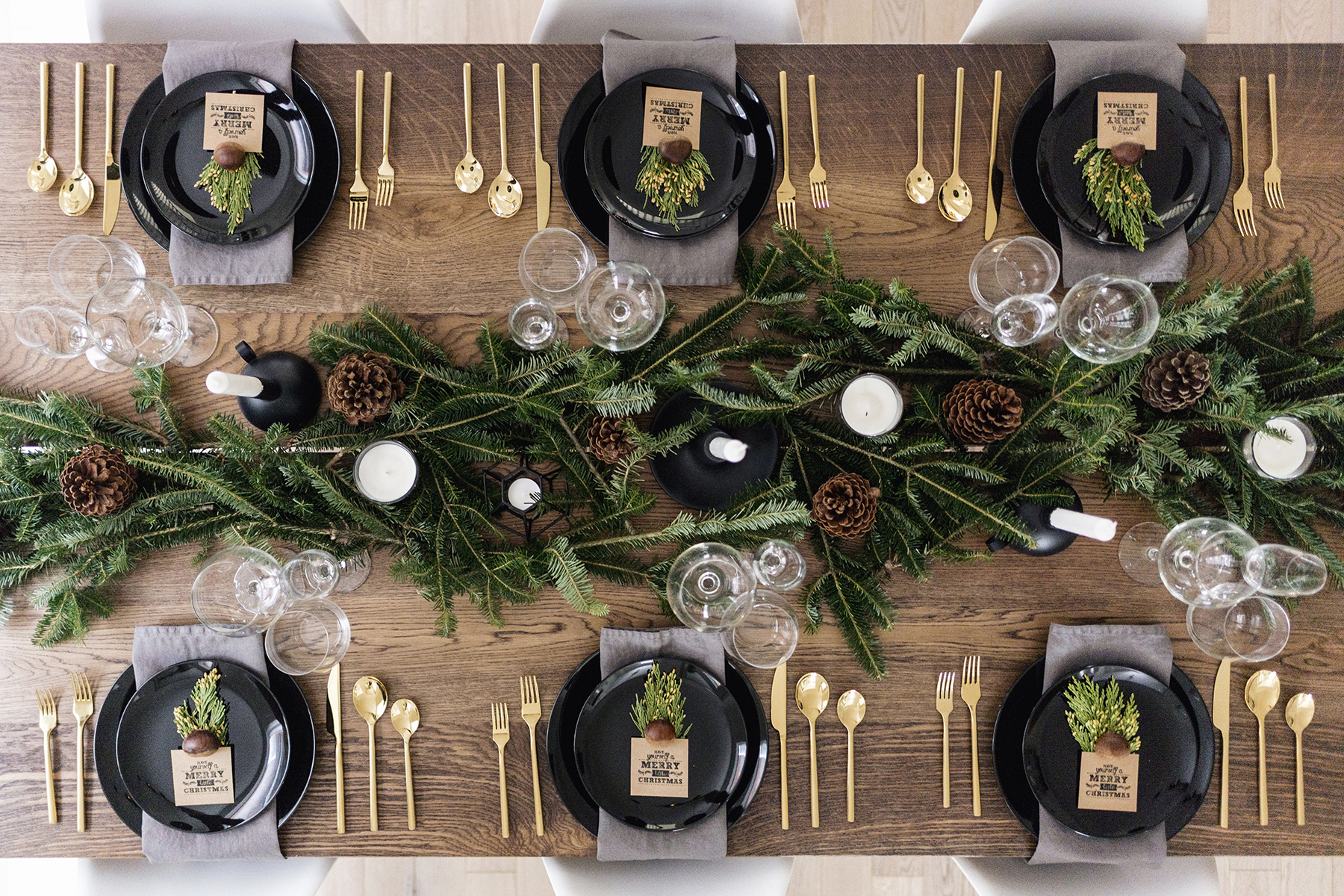 Modern + classy Christmas tablescape with gold flatware, branches + pinecones | Happy Grey Lucky