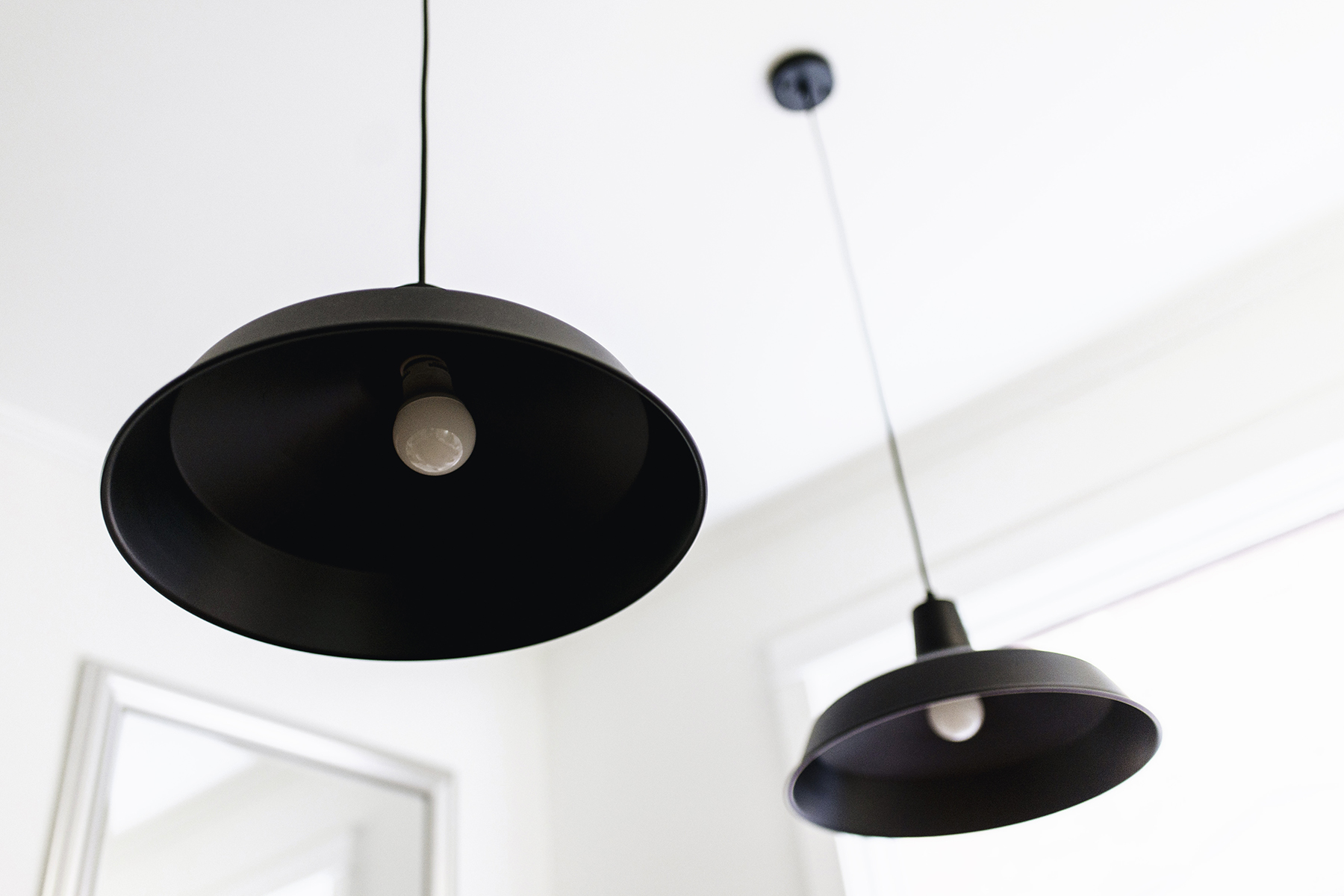 Scandinavian-inspired dining room - black warehouse pendant lamps | Happy Grey Lucky