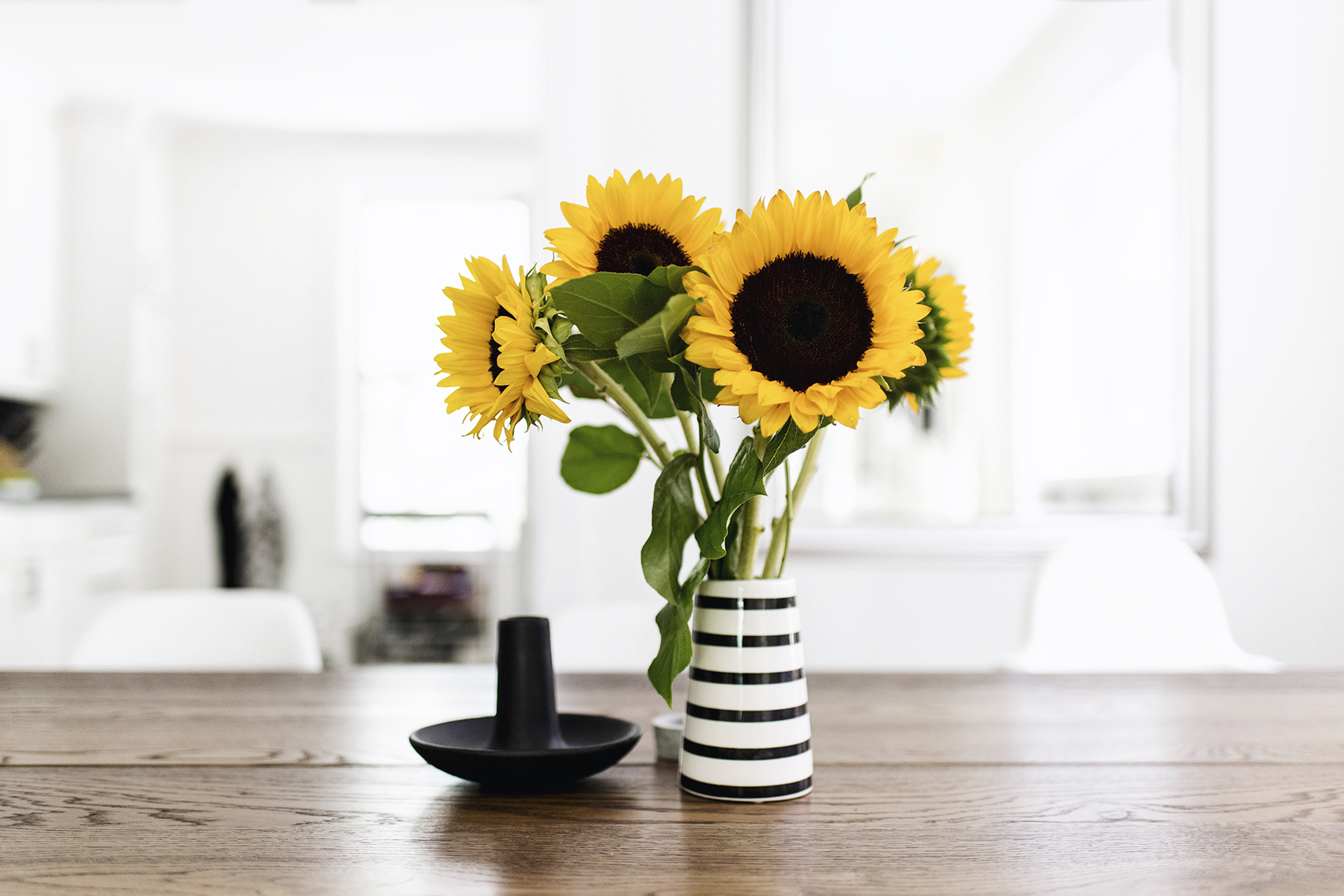 Scandinavian-inspired dining room - House Doctor candle holder + striped vase | Happy Grey Lucky