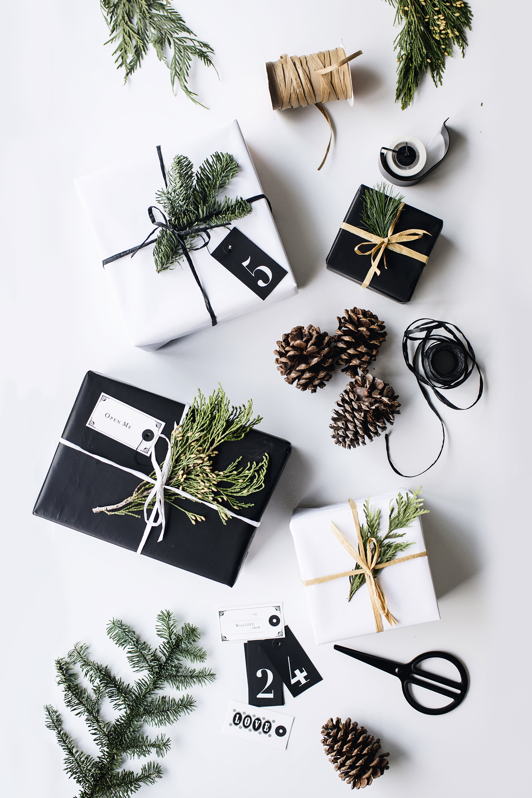 Simple + modern DIY gift wrapping inspiration with kraft paper + greenery | Happy Grey Lucky
