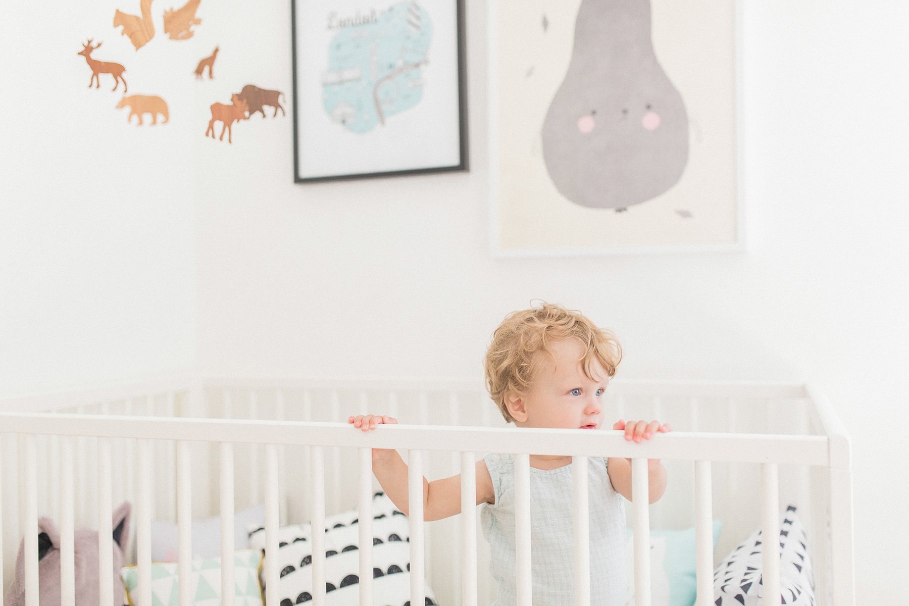 Scandinavian shared kids room - light-filled, pastel baby + toddler playroom - Ikea Gulliver crib, Tellkiddo toy bag, Fine Little Day pear poster | Happy Grey Lucky