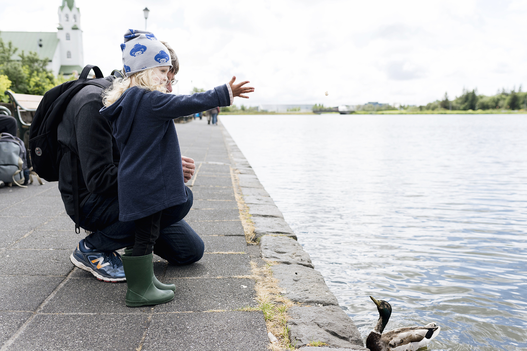 Feeding ducks at Tjörnin lake in Reykjavik, Iceland with young kids - family travel with a baby & toddler | Happy Grey Lucky