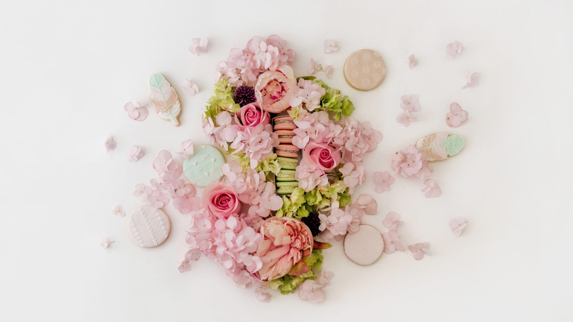Flowers, macarons + cookies flatlay | A wild + boho baby shower