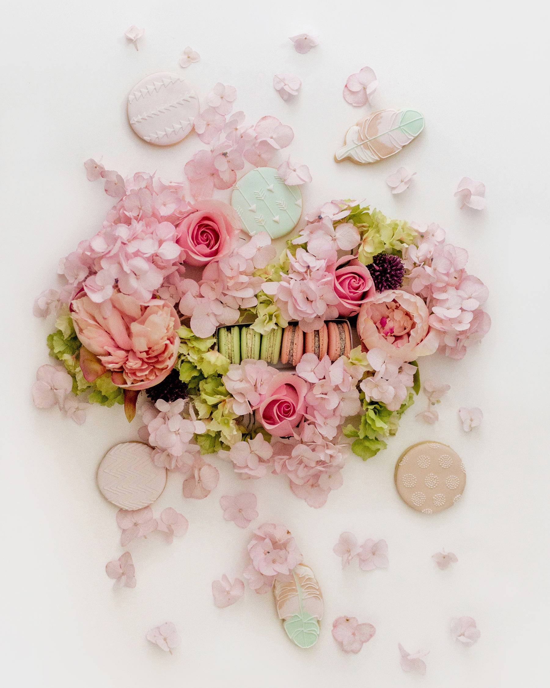 Flower, macaron + cookie flatlay | A wild + boho baby shower with pastels and rustic details