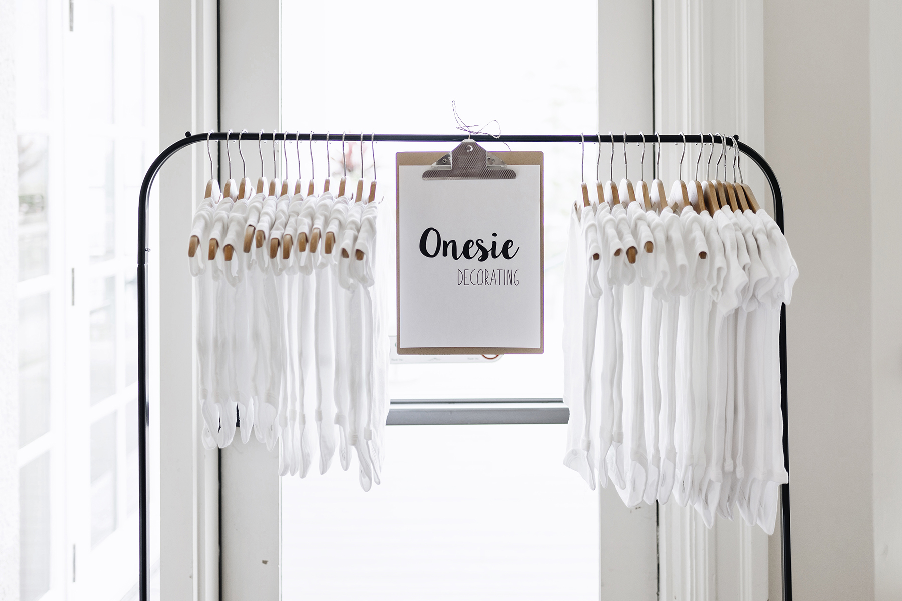 Onesie painting | A wild + boho baby shower with pastel colours + rustic details