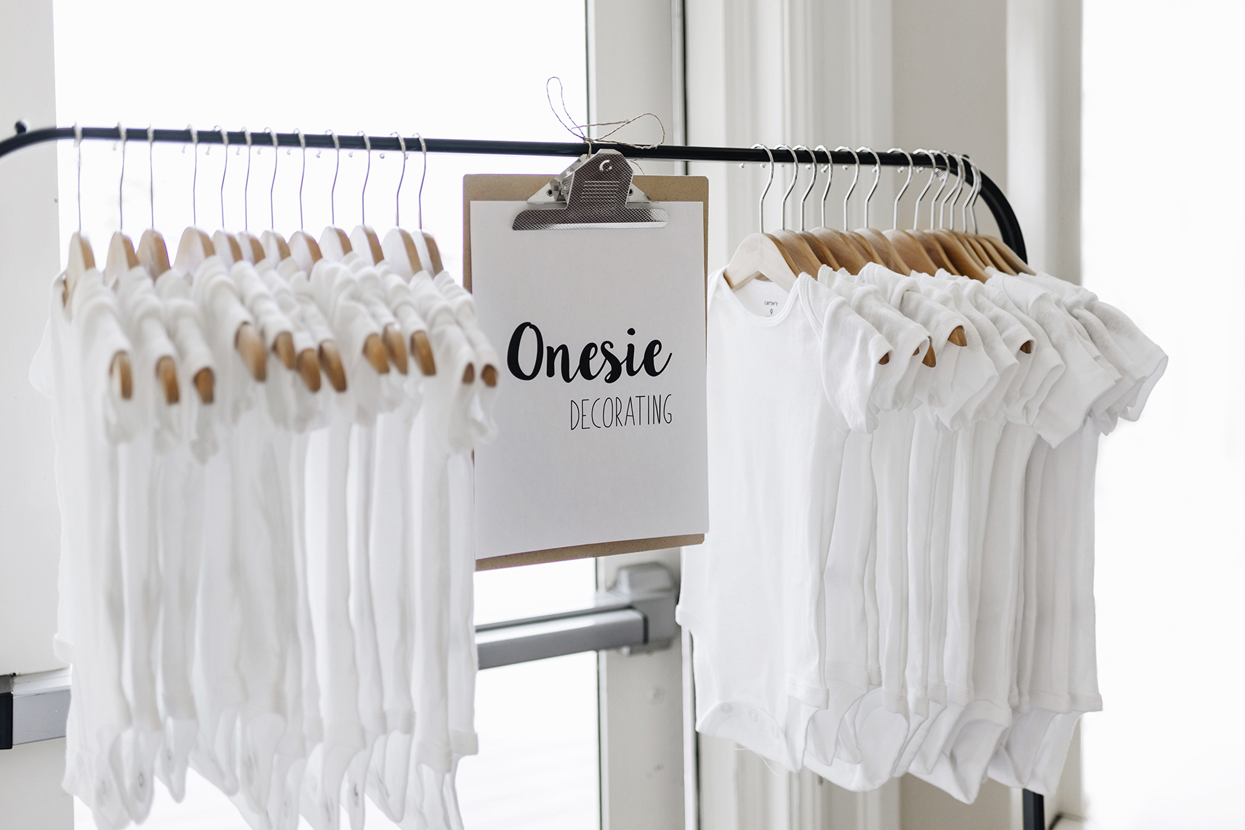 Onesie decorating | A wild + boho baby shower with pastel colours + rustic details