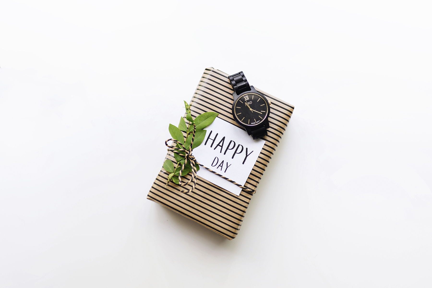 Natural kraft paper + greenery gift wrap with Jord wood watch | Father's Day gift guide