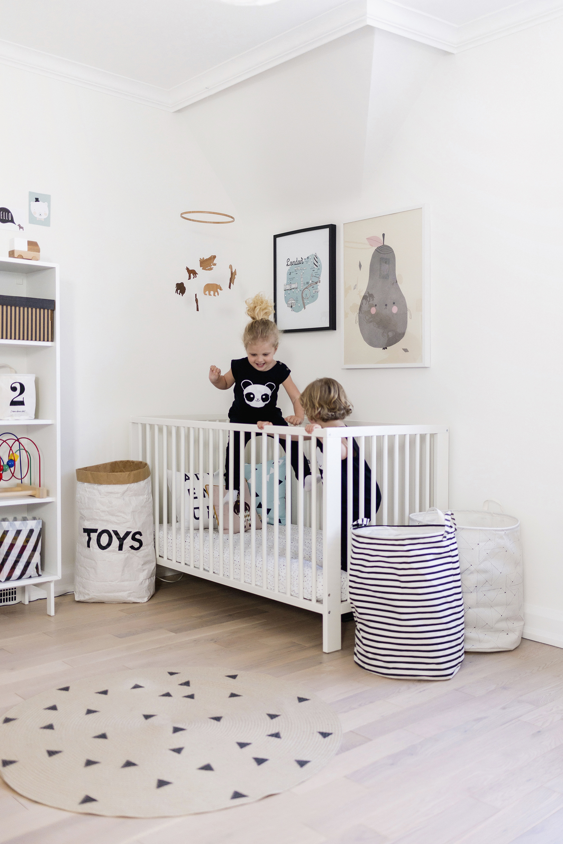 Modern, pastel Scandinavian-inspired nursery + shared kids room | Happy Grey Lucky