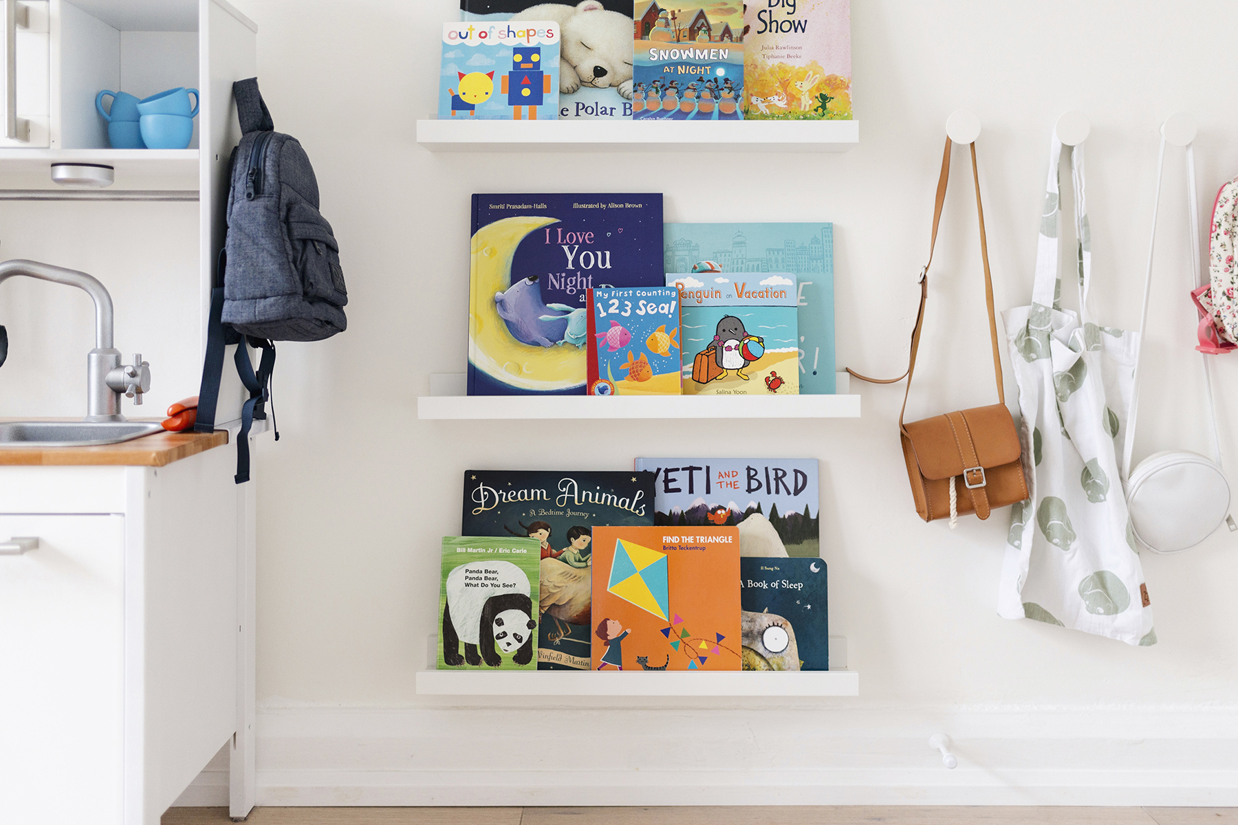 Scandinavian kids room with RIBBA picture ledges used as open-facing bookshelves | Happy Grey Lucky