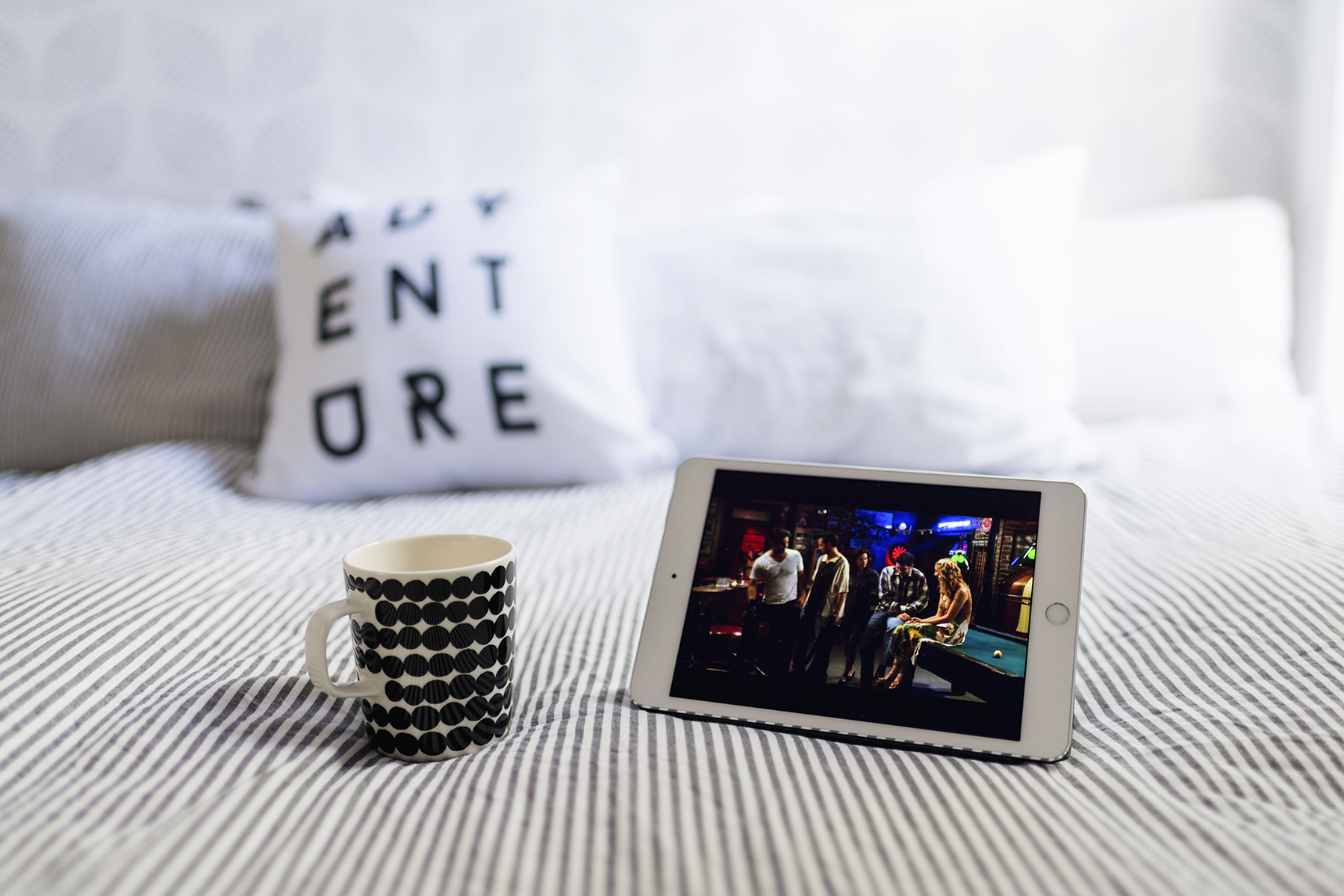 Netflix and coffee in bed | 5 ways to relax and unwind at home | Happy Grey Lucky