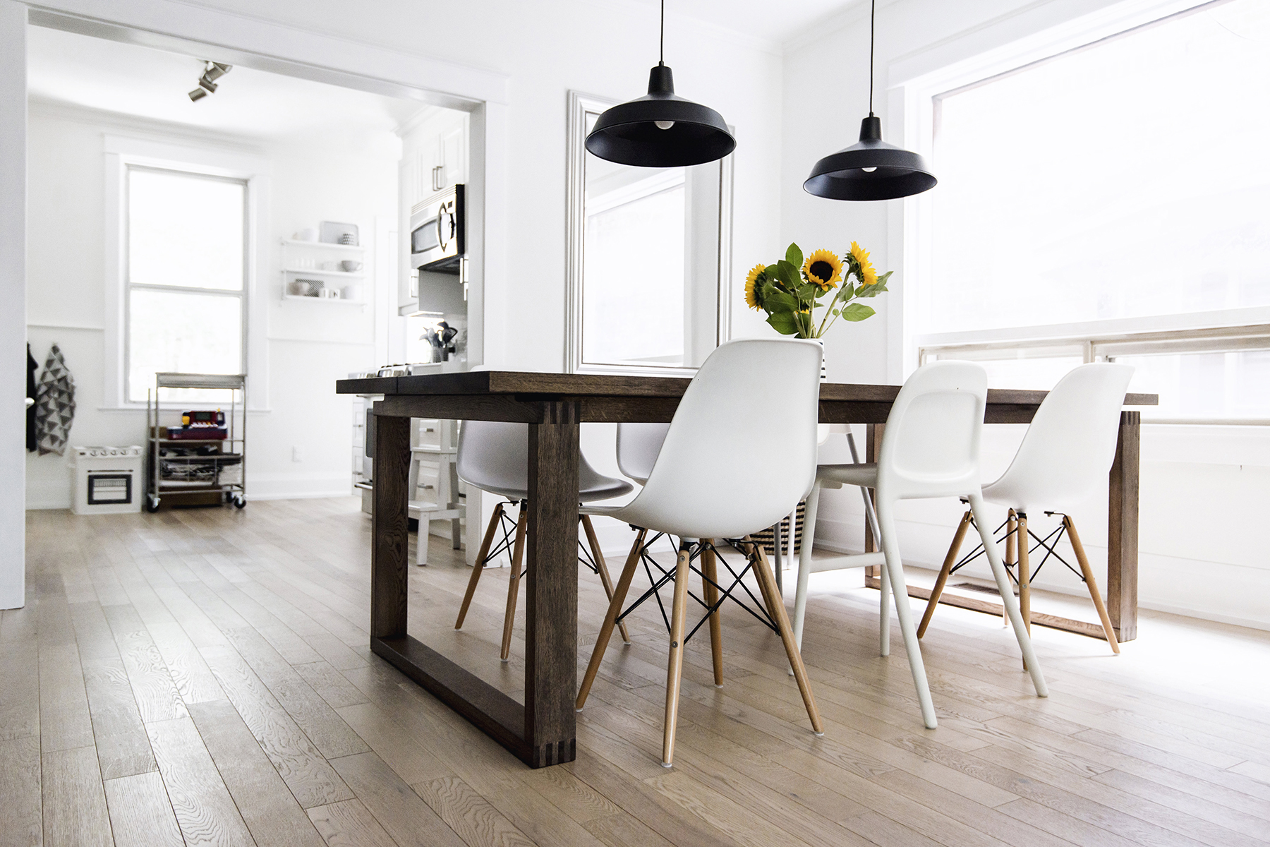 Scandinavian dining room with light wood floors and white walls - Top 10 tips for adding Scandinavian style to your home | Happy Grey Lucky