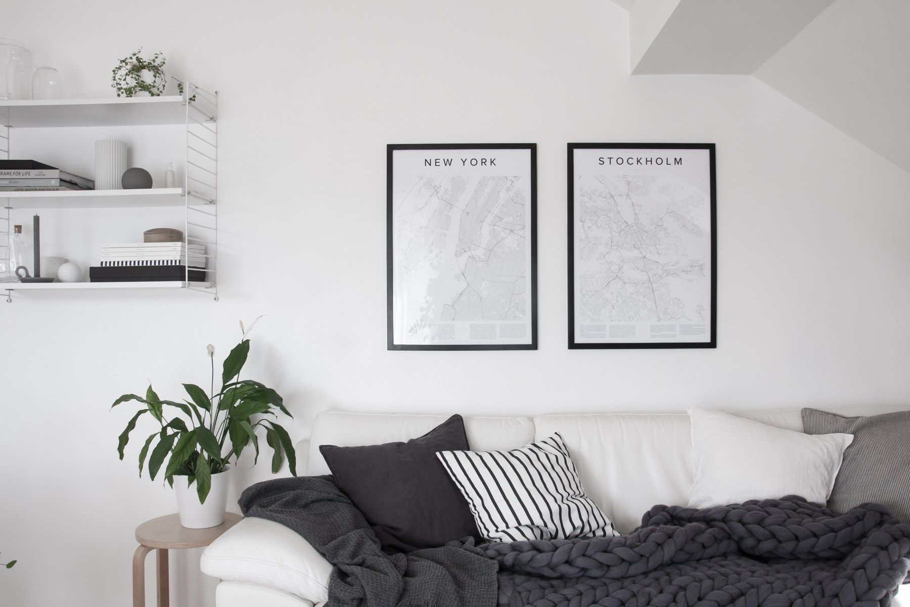 Scandinavian living room with white walls and map wall art - Top 10 tips for adding Scandinavian style to your home | Happy Grey Lucky