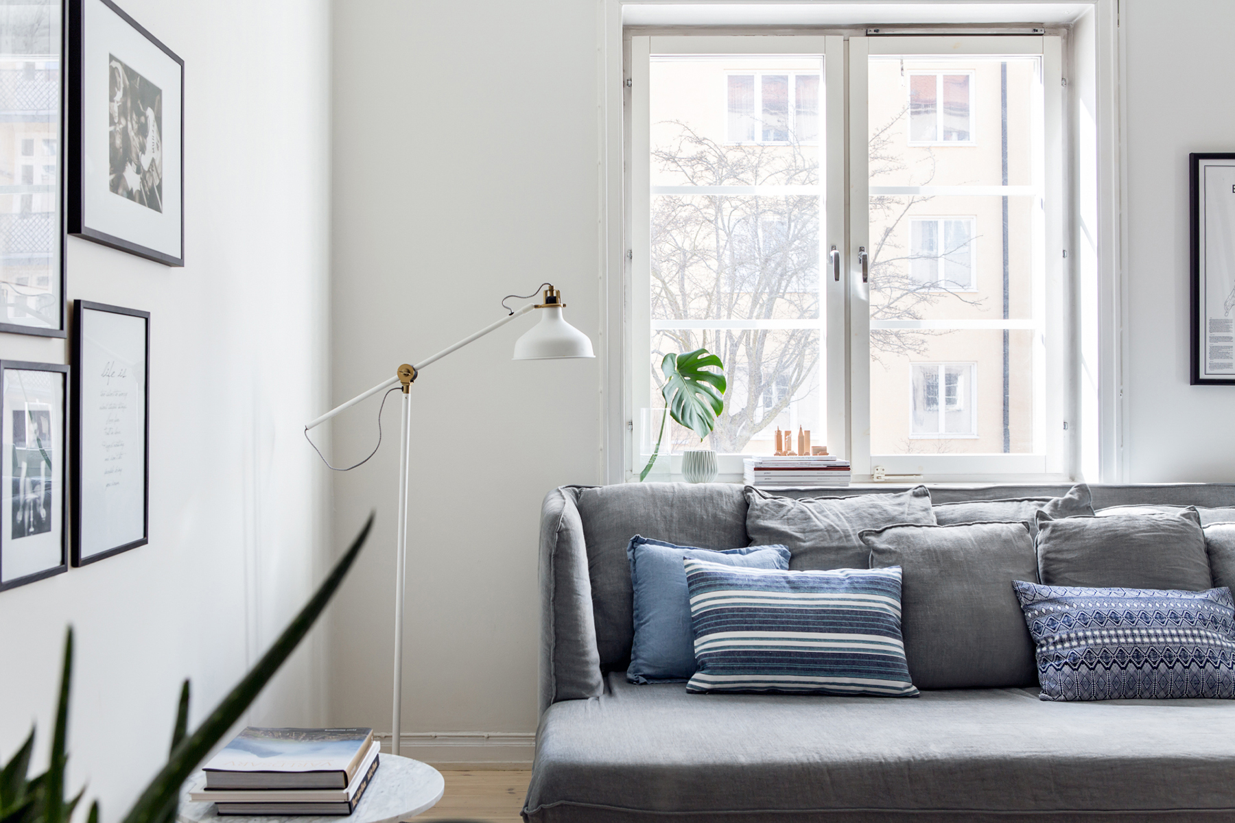 Scandinavian living room with grey sofa - Top 10 tips for adding Scandinavian style to your home | Happy Grey Lucky