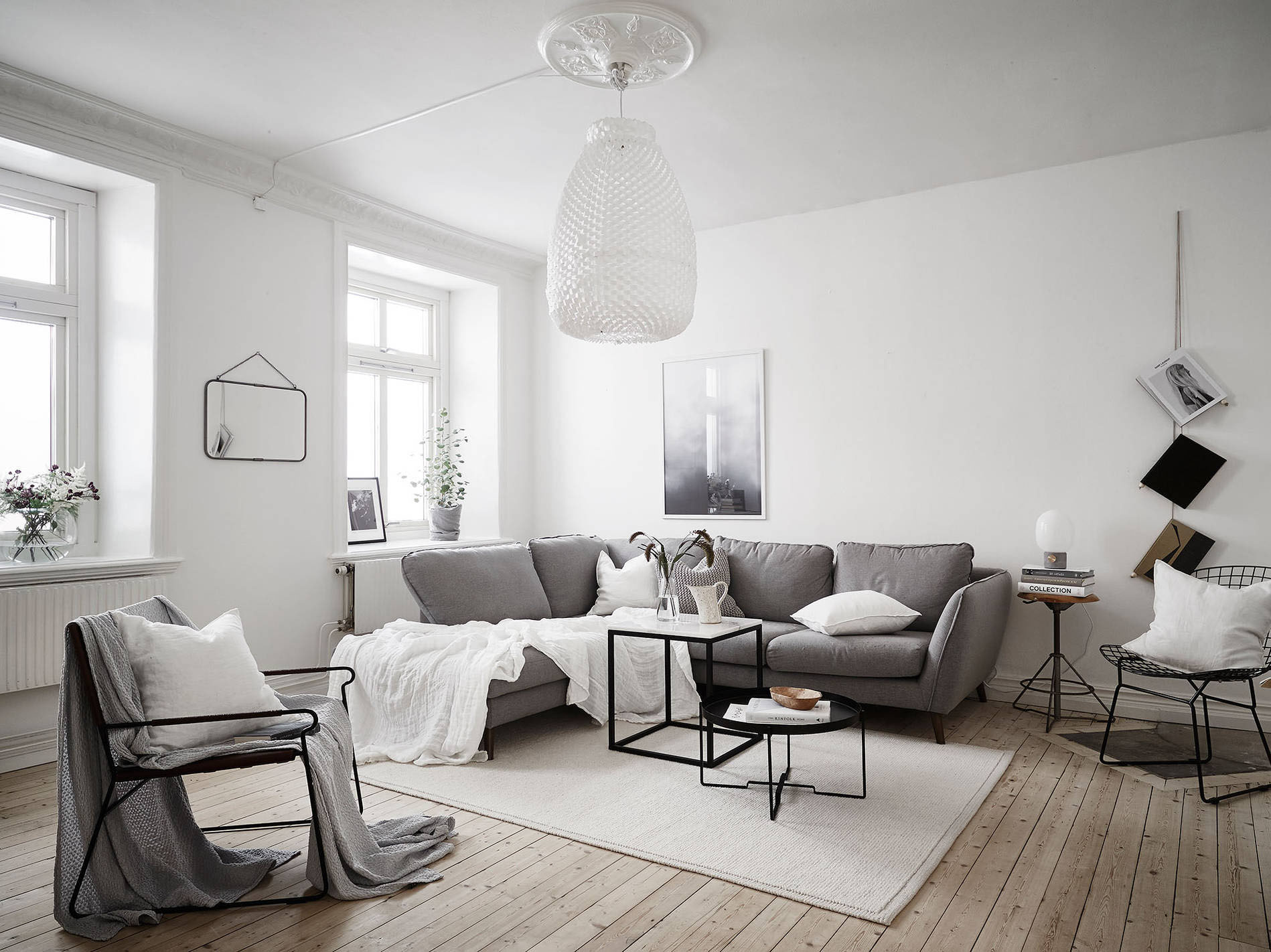 Scandinavian living room with large pendant lamp - Top 10 tips for adding Scandinavian style to your home | Happy Grey Lucky